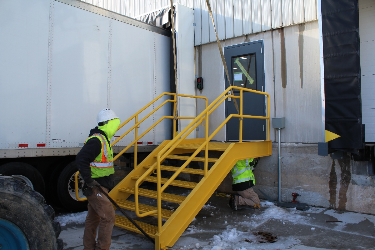 Building Exterior Maintenance of a steel stairwell for a loading dock
