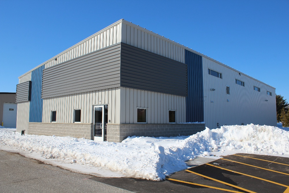 Exterior of manufacturing building constructed by A.C.E. Building Service with the help of Butler Manufacturing pre-engineered metal building systems