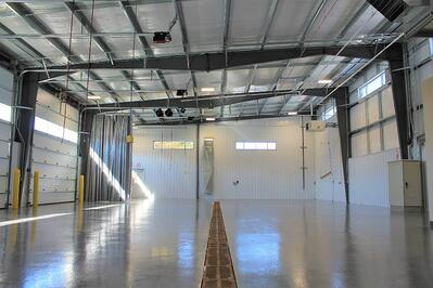 The inside of a warehouse or manufacturing facility that was designed with natural lighting for the employee's benefit and retention
