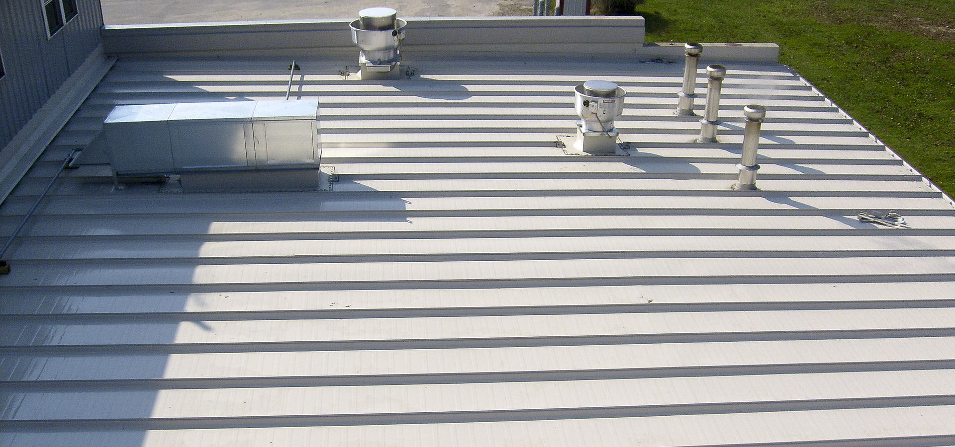 commercial reroofing and air vent installation